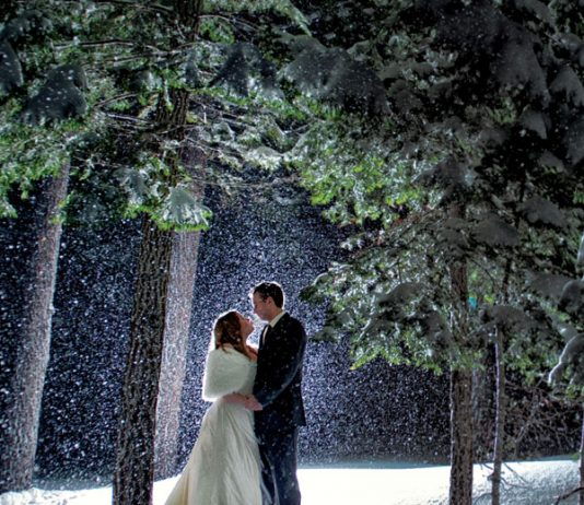 """A wintertime wedding in Lake Tahoe brings some key benefits: Prices are lower, hotels are less crowded, and the snow-covered mountains are gorgeous. Photographers Tara and Matt Theilen of Theilen Photography prefer the natural winter """"sunset"""" lighting as well."""